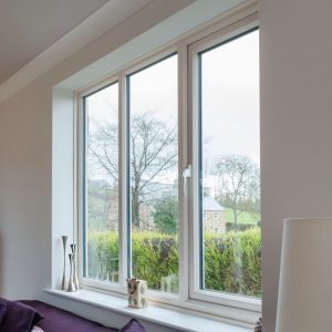 White uPVC Windows in a home looking out onto a garden.