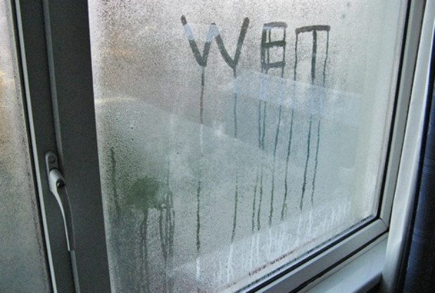 Condensation on a window with 'WET'