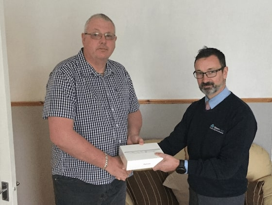 Mr. Patterson from Highbury Vale in Nottingham gets his iPad prize.