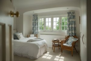 Modern heritage style windows keeping a room warm.