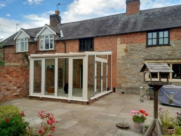 Cream all glass conservatory built after planning permission.