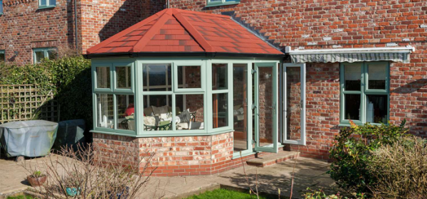 Green brick and glass conservatory built with planning permission in Nottingham.