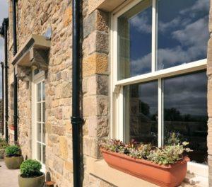 Cream timber sash windows on cottage near Leicester.