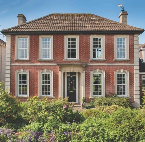 Sliding sash windows on a grand house.