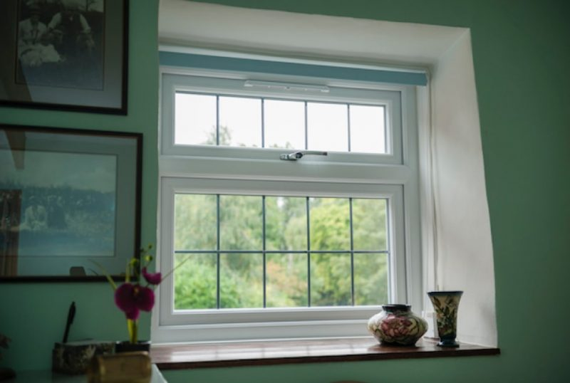 Looking out of a classic style white uPVC window.