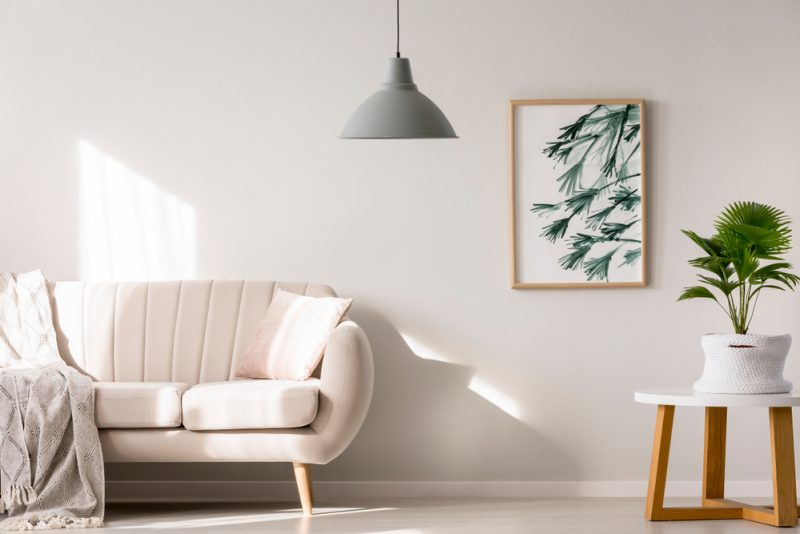 A white sofa in a white room.