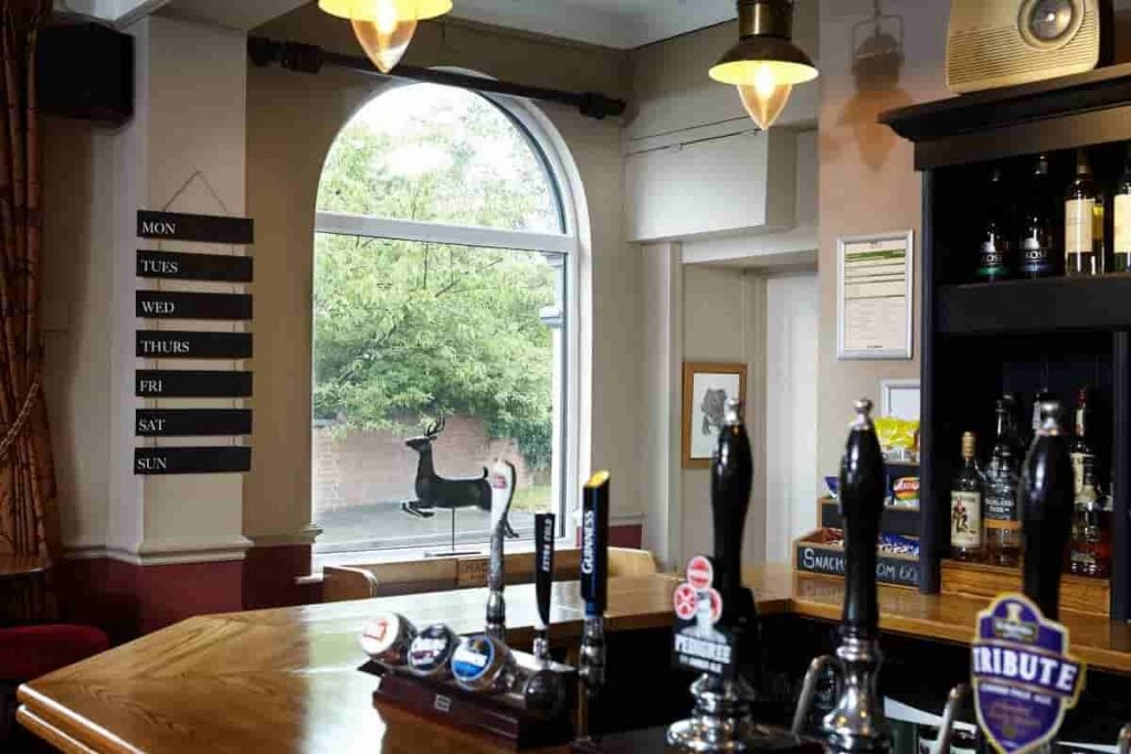 Inside the Roebuck Inn with large aluminium window.