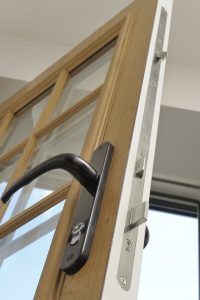 View of the locking system of a wood effect composite door.