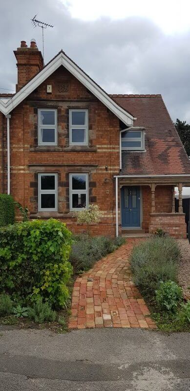 Outside a home with green Heritage flush Windows Newark, Nottingham.
