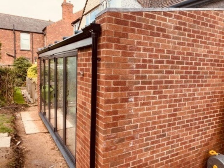 Outside a brick and glass Kitchen Extension in Mapperley, Nottingham.