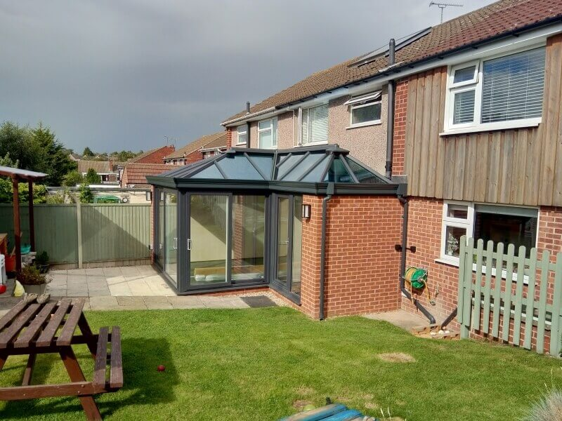 Outside Anthracite Grey and red brick Conservatory in Keyworth.