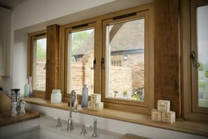 Timber windows in a white kitchen.