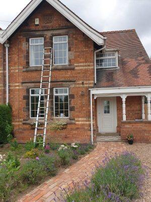 Heritage windows on brick house.