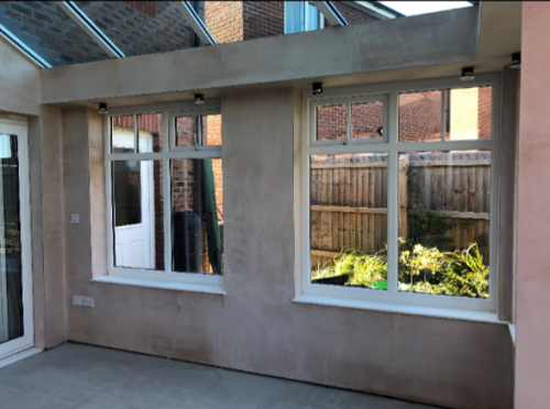 inside a White windows and roof on a modern brick conservatory.